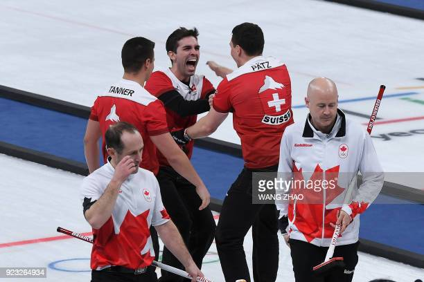 TOPSHOT Switzerland's players celebrate after winning the curling men's bronze medal game during the Pyeongchang 2018 Winter Olympic Games at the...