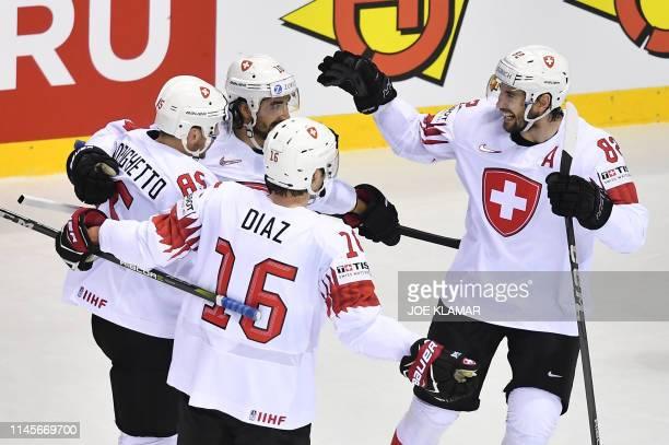 Switzerland's players celebrate scoring during the IIHF Men's Ice Hockey World Championships quarter-final match between Canada and Switzerland on...