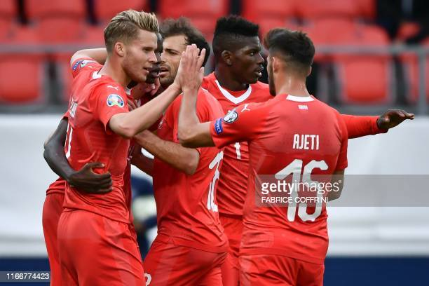 Switzerland's players celebrate scoring their team's second goal during the Euro 2020 qualifying football match between Switzerland and Gibraltar, at...