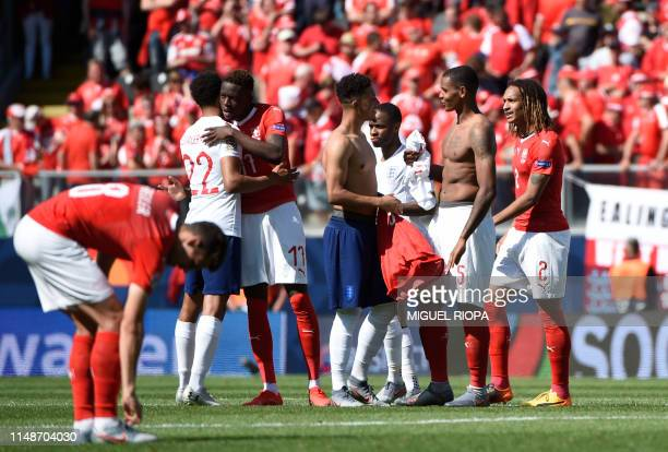 Switzerland's players congratulate England's players after the UEFA Nations League third place playoff football match between Switzerland and England...