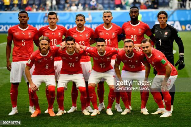 Switzerland's players defender Manuel Akanji midfielder Granit Xhaka defender Ricardo Rodriguez midfielder Valon Behrami defender Johan Djourou...