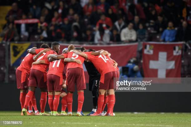 Switzerland's players huddle prior to the FIFA World Cup 2022 Group C qualification football match between Switzerland and Northern Ireland at the...