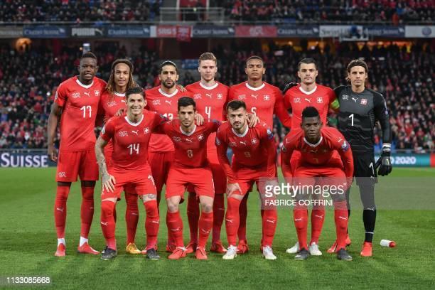 Switzerland's players midfielder Denis Zakaria defender Kevin Mbabu defender Ricardo Rodriguez defender Nico Elvedi defender Manuel Akanji midfielder...