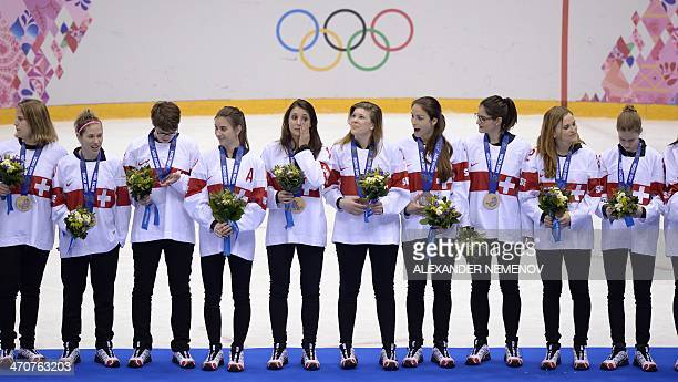 Switzerland's players pose with their bronze medal on the podium during the Women's Ice Hockey Medal Ceremony at the Bolshoy Ice Dome plaza during...