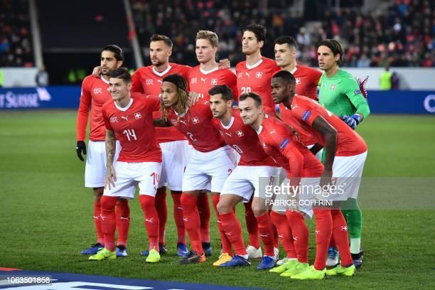 Switzerland's players second row defender Ricardo Rodriguez forward Haris Seferovic defender Nico Elvedi Timm Klose and goalkeeper Yann Sommer and...