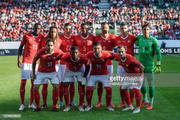 Switzerland's players second row midfielder Edimilson Fernandes defender Kevin Mbabu defender Fabian Schaer defender Manuel Akanji forward Haris...