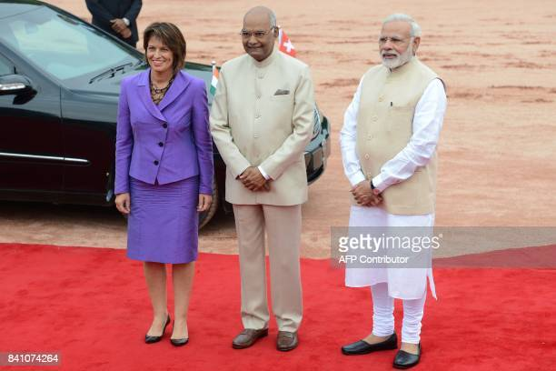 Switzerland's President Doris Leuthard poses with her Indian counterpart Ram Nath Kovind and India's Prime Minister Narendra Modi upon her arrival...