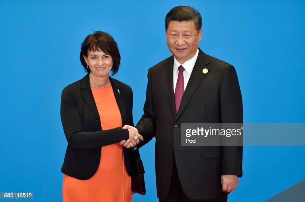 Switzerland's President Doris Leuthard shakes hands with Chinese President Xi Jinping during the welcome ceremony for the Belt and Road Forum at the...