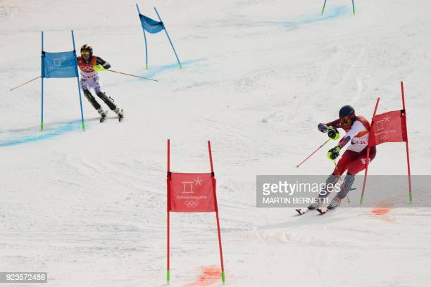 TOPSHOT Switzerland's Ramon Zenhaeusern competes with Germany's Alexander Schmid in the Alpine Skiing Team Event quarterfinals at the Jeongseon...