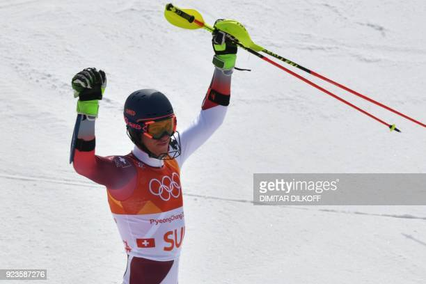 Switzerland's Ramon Zenhaeusern reacts after competing in the Alpine Skiing Team Event final at the Jeongseon Alpine Center during the Pyeongchang...