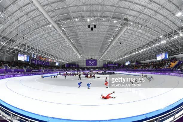 TOPSHOT Switzerland's Ramona Haerdi falls in the women's mass start semifinal speed skating event during the Pyeongchang 2018 Winter Olympic Games at...