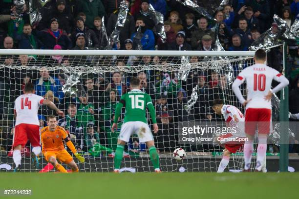 Switzerlands Ricardo Rodriguez scores the opening goal from the penalty spot during the FIFA 2018 World Cup Qualifier PlayOff First Leg between...
