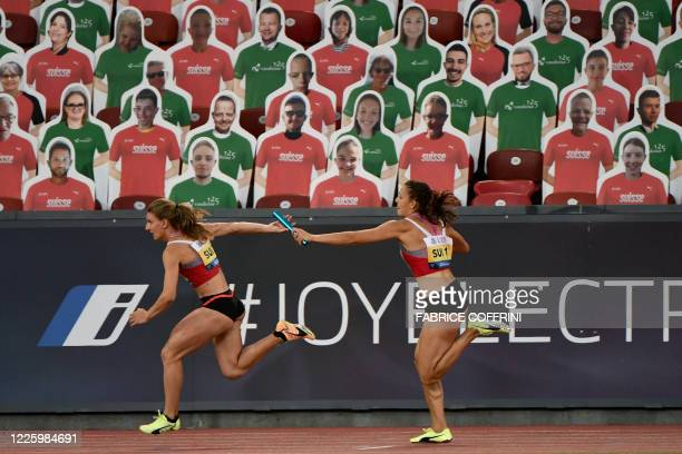 Switzerland's Riccarda Dietsche and Ajla Del Ponte compete in the women's 3x100m relay in front of cardboards depicting fake spectators, during the...