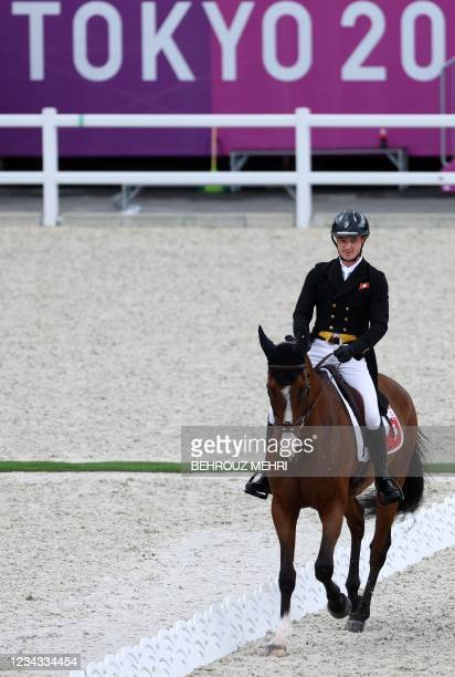 Switzerland's Robin Godel riding Jet Set competes in the equestrian's eventing team and individual dressage during the Tokyo 2020 Olympic Games at...