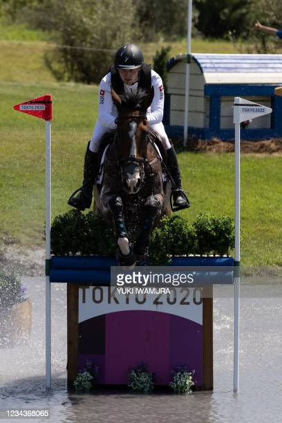 Switzerland's Robin Godel riding Jet Set competes in the equestrian's eventing team and individual cross country during the Tokyo 2020 Olympic Games...