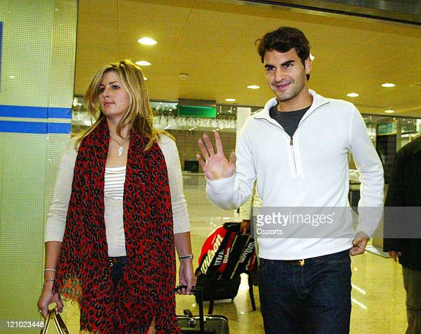Switzerland's Roger Federer and his girlfriend Mirka Vavrinec arrive at the Shanghai Pudong International Airport on November 6 2006 to attend the...
