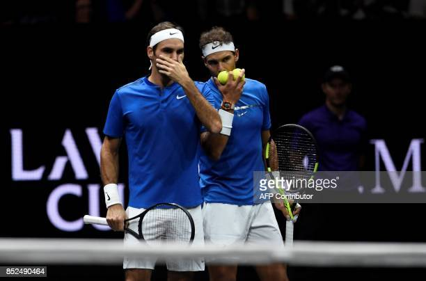 Switzerland's Roger Federer and Spain's Rafael Nadal of Team Europe are seen during their double tennis match against Team World's Sam Querrey and...