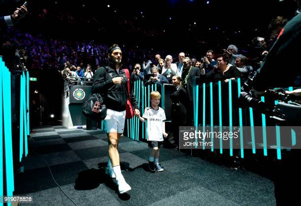 Switzerland's Roger Federer arrives on court ahead of his quarterfinal singles tennis match against Netherlands Robin Haase for the ABN AMRO World...