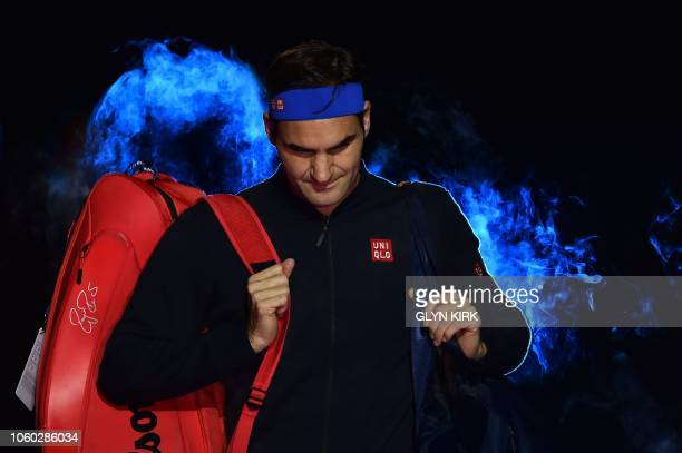 Switzerland's Roger Federer arrives on court to play Japan's Kei Nishikori during their singles round robin match on day one of the ATP World Tour...