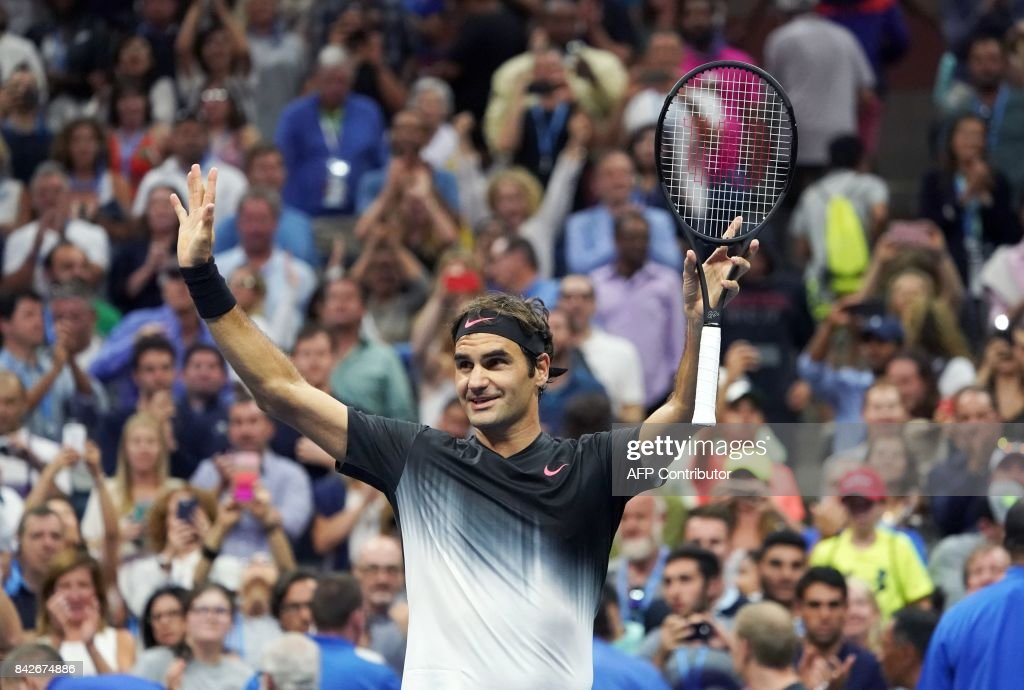 TOPSHOT - Switzerland's Roger Federer celebrates after defeating Germany's Philipp Kohlschreiber during their 2017 US Open Men's Singles Round 4 match at the USTA Billie Jean King National Tennis Center in New York on September 4, 2017. Federer won the match 6-4, 6-2, 7-5. /