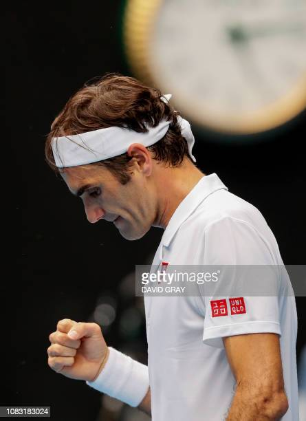Switzerland's Roger Federer celebrates after victory over Britain's Daniel Evans in their men's singles match on day three of the Australian Open...