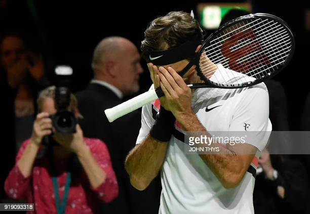 TOPSHOT Switzerland's Roger Federer celebrates after victory over Netherlands Robin Haase in their quarterfinal singles tennis match for the ABN AMRO...