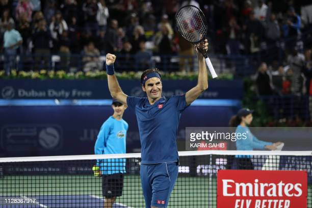 Switzerland's Roger Federer celebrates after winning the final match at the ATP Dubai Tennis Championship in the Gulf emirate of Dubai on March 2...