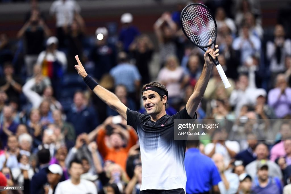 TOPSHOT - Switzerland's Roger Federer celebrates defeating Frances Tiafoe of the US during their 2017 US Open Men's Singles match at the USTA Billie Jean King National Tennis Center in New York on August 29, 2017. PHOTO / Jewel SAMAD
