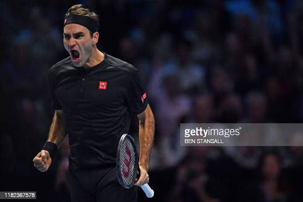 Switzerland's Roger Federer celebrates his straight sets win over Serbia's Novak Djokovic in their men's singles round-robin match on day five of the...