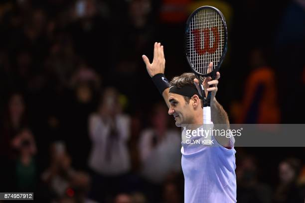 TOPSHOT Switzerland's Roger Federer celebrates his three set victory over Croatia's Marin Cilic in their men's singles roundrobin match on day five...