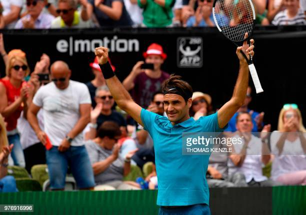 Switzerland's Roger Federer celebrates winning against Canada's Milos Raonic after the final match at the ATP Mercedes Cup tennis tournament in...