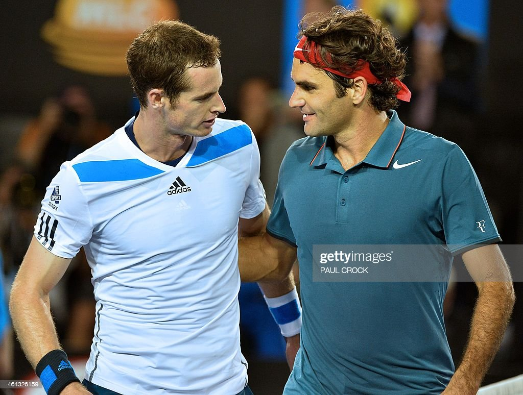 Switzerland's Roger Federer (R) embraces as he celebrates after victory in his men's singles match against Britain's Andy Murray (L) on day ten of the 2014 Australian Open tennis tournament in Melbourne on January 22, 2014. IMAGE