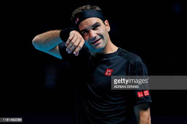 TOPSHOT Switzerland's Roger Federer gestures against Austria's Dominic Thiem during their men's singles roundrobin match on day one of the ATP World...