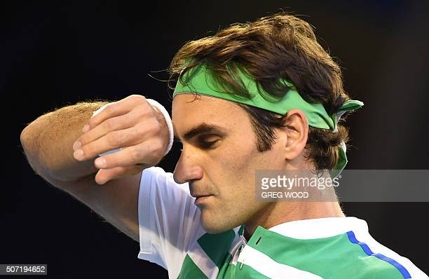 Switzerland's Roger Federer gestures during his men's singles semifinal match against Serbia's Novak Djokovic on day eleven of the 2016 Australian...