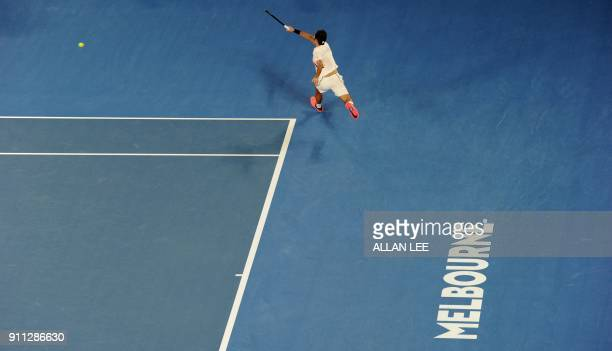 TOPSHOT Switzerland's Roger Federer hits a return against Croatia's Marin Cilic during their men's singles final match on day 14 of the Australian...