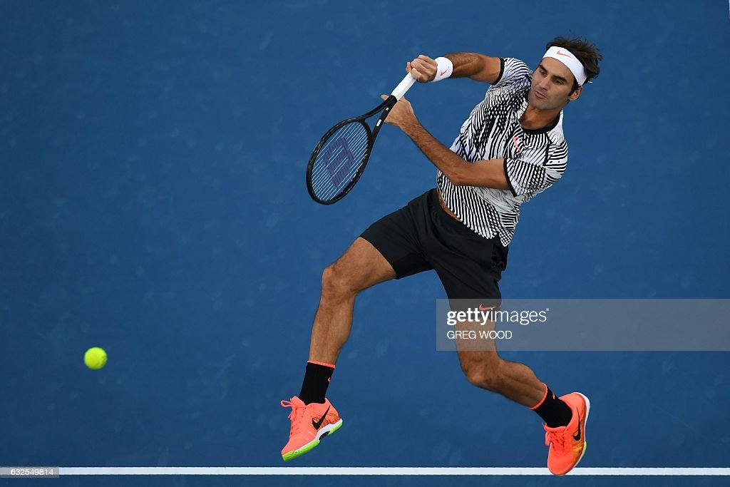 TOPSHOT - Switzerland's Roger Federer hits a return against Germany's Mischa Zverev during their men's singles quarter-final match on day nine of the Australian Open tennis tournament in Melbourne on January 24, 2017. / AFP / GREG