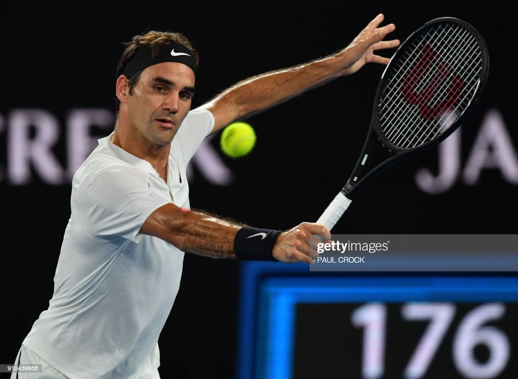 Switzerland's Roger Federer hits a return against South Korea's Chung Hyeon during their men's singles semi-finals match on day 12 of the Australian Open tennis tournament in Melbourne on January 26, 2018. / AFP PHOTO / Paul Crock / -- IMAGE