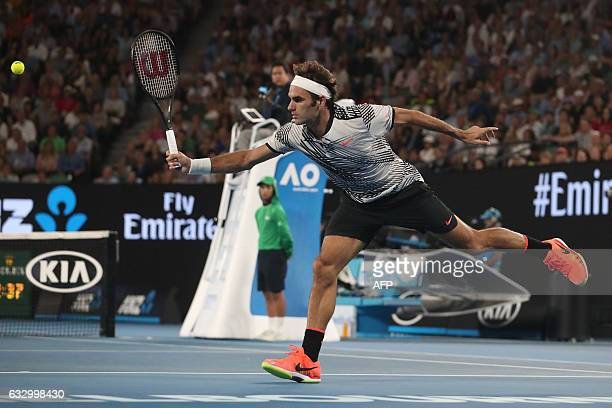 Switzerland's Roger Federer hits a return against Spain's Rafael Nadal during the men's singles final on day 14 of the Australian Open tennis...