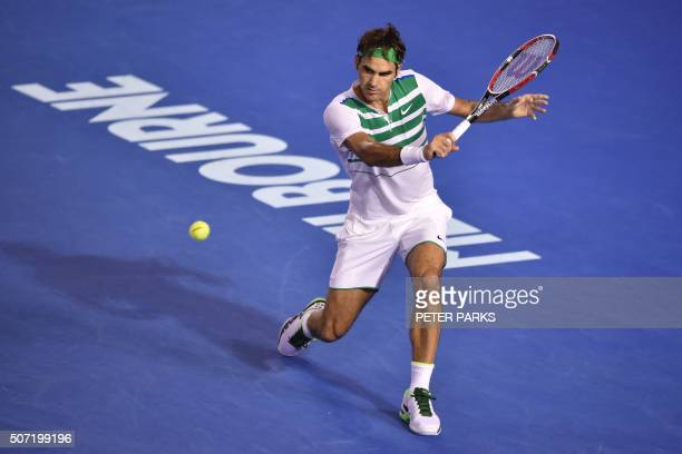 Switzerland's Roger Federer hits a return during his men's singles semifinal match against Serbia's Novak Djokovic on day eleven of the 2016...