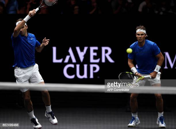 Switzerland's Roger Federer hits a return in front of his teammate of team Europe Spain's Rafael Nadal during their double tennis match against Team...