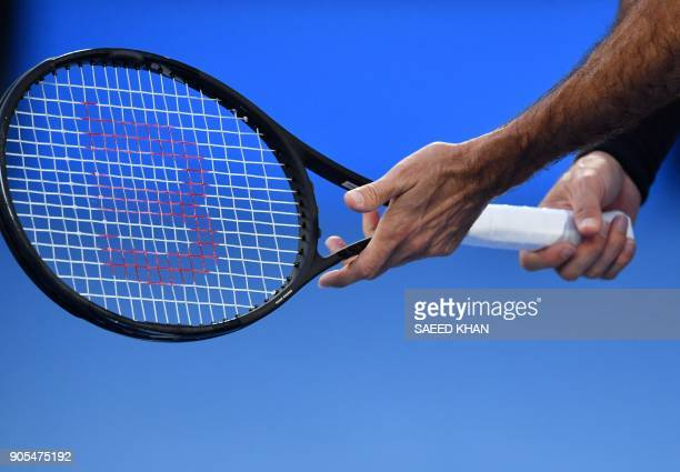 Switzerland's Roger Federer holds his racquet during their men's singles first round match against Slovenia's Aljaz Bedene on day two of the...