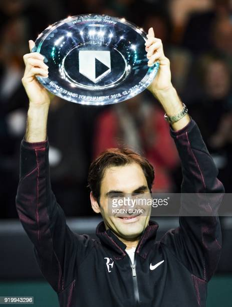 Switzerland's Roger Federer holds his trophy after winning the final match against Bulgary's Grigor Dimitrov at the ABN AMRO World Tennis Tournament...