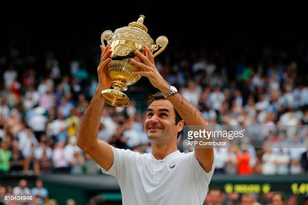 TOPSHOT Switzerland's Roger Federer holds the winner's trophy after beating Croatia's Marin Cilic in their men's singles final match during the...
