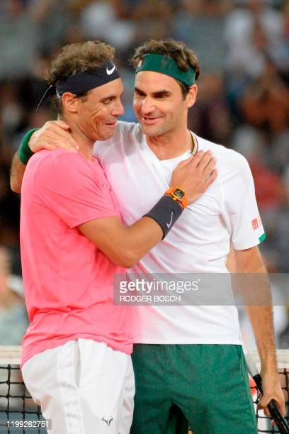 Switzerland's Roger Federer hugs Spain's Rafael Nadal during their tennis match at The Match in Africa at the Cape Town Stadium in Cape Town on...