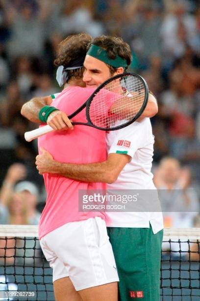 Switzerland's Roger Federer is hugged by Spain's Rafael Nadal during their tennis match at The Match in Africa at the Cape Town Stadium in Cape Town...