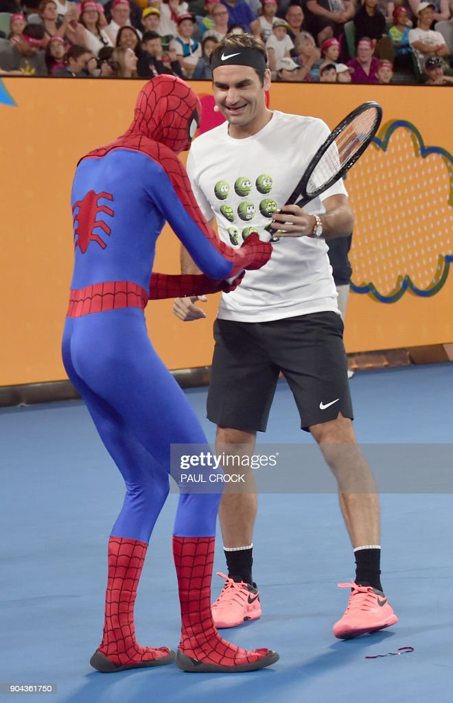 Switzerland's Roger Federer (R) jokes with an actor dressed as Spider-Man during the Kids Day ahead of the Australian Open tennis tournament in Melbourne on January 13, 2018. /