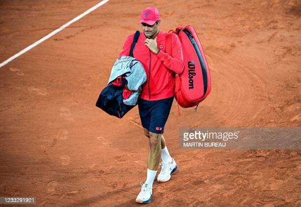 Switzerland's Roger Federer leaves the court after winning against Germany's Dominik Koepfer during their men's singles third round tennis match on...