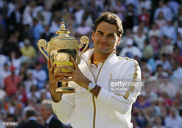 Switzerland's Roger Federer lifts the Wimbledon Trophy after beating Andy Roddick of the US 57 76 76 36 1614 in the Men's Singles Final of the 2009...