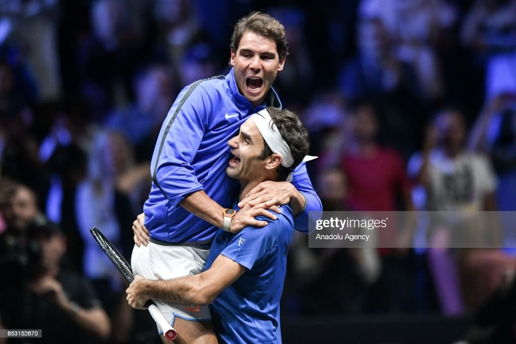 Switzerland's Roger Federer of Team Europe celebrates with his team mate Spanish Rafael Nadal after his match against Australia's Nick Kyrgios (not seen) of the Team World in Prague, Czech Republic on September 24, 2017. It is a three day (22 to 24 September 2017) tournament pitting a team of the six best tennis players from Europe against six opponents from the rest of the world. The tournament has been named in honor of Australian tennis legend Rod Laver. At the beginning of the exhibition project was a tennis player Roger Federer, whose company TEAM8 is the main owner of the competition.