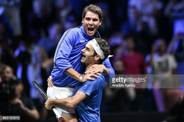 Switzerland's Roger Federer of Team Europe celebrates with his team mate Spanish Rafael Nadal after his match against Australia's Nick Kyrgios of the...